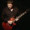 Acoustic Guitar Lessons, Electric Guitar Lessons, Music Lessons with Andrew Morriss Refractive Music.