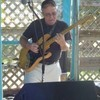Acoustic Guitar Lessons, Electric Guitar Lessons, Voice Lessons, Music Lessons with Eric Bass.